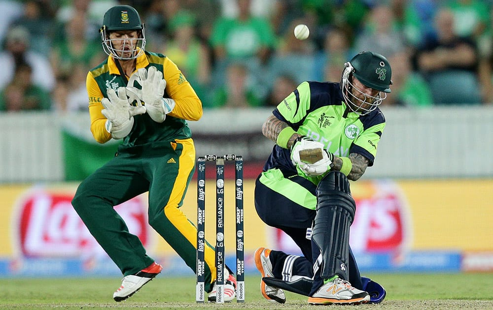 Ireland's John Mooney plays the ball over South African wicketkeeper Quinton De Kock's head during their Cricket World Cup Pool B match in Canberra, Australia.