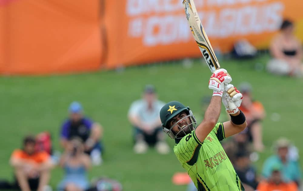 Pakistan's Ahmad Shahzad watches as he hits the ball to the boundary while batting against the United Arab Emirates during their Cricket World Cup Pool B match in Napier, New Zealand.