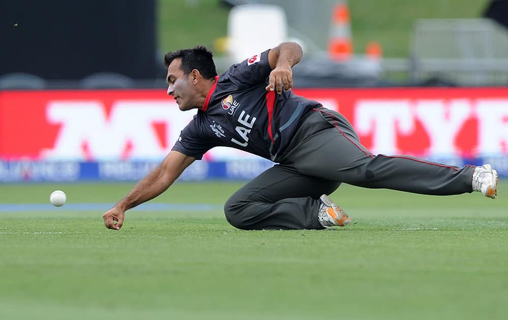 United Arab Emirates Mohamed Tauqir attempts to catch the ball while fielding during their Cricket World Cup Pool B match against Pakistan in Napier, New Zealand.