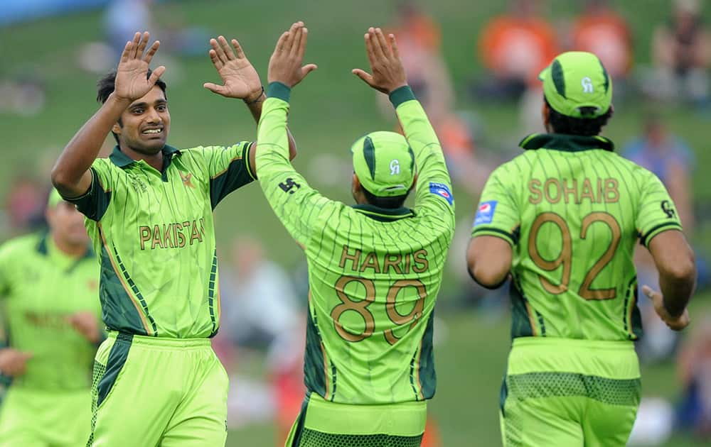 Pakistan's Rahat Ali, is congratulated by teammates Haris Sohail and Sohaib Maqsood, after dismissing United Arab Emirates batsman Amjad Ali during their Cricket World Cup Pool B match in Napier, New Zealand.