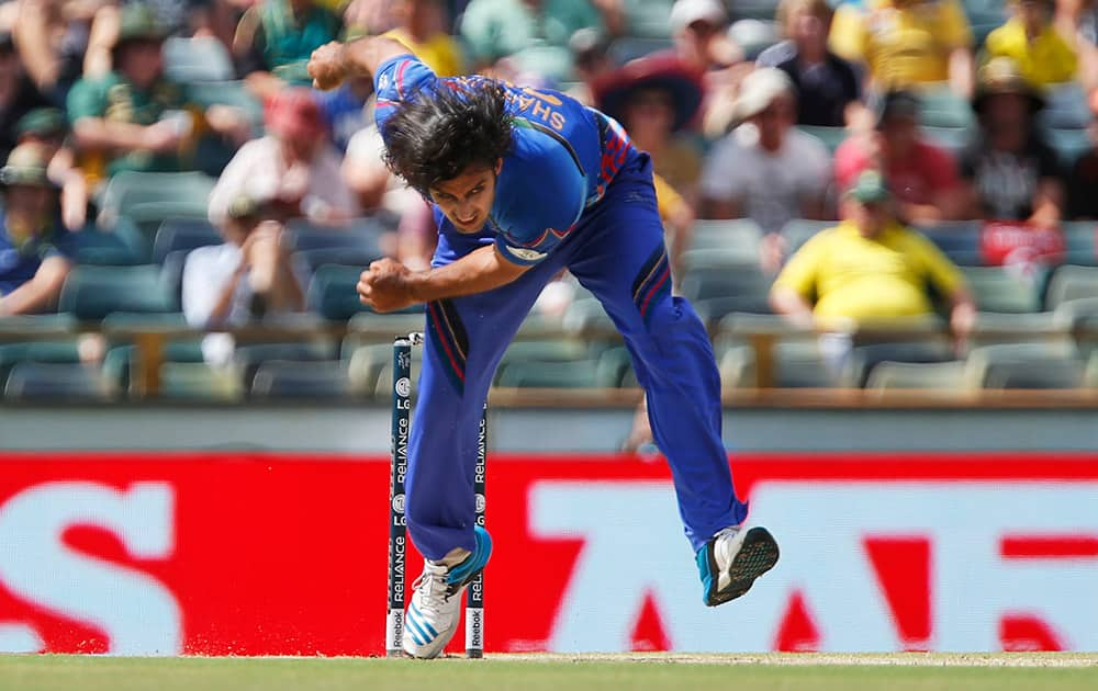 Afghanistan's Shapoor Zadran bowls during their Cricket World Cup Pool A match against Australia in Perth, Australia.