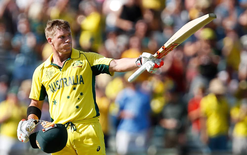 Australia's David Warner celebrates after scoring a century during their Cricket World Cup Pool A match against Afghanistan in Perth, Australia.