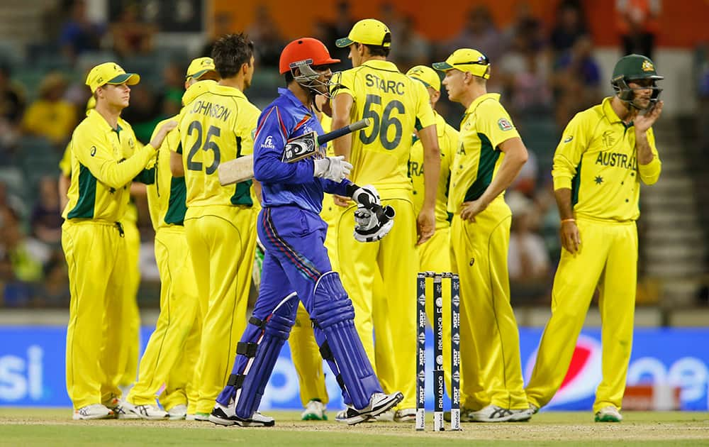 Afghanistan's Usman Ghani walks back towards the pavilion after being dismissed during their Cricket World Cup Pool A match against Australia in Perth, Australia.