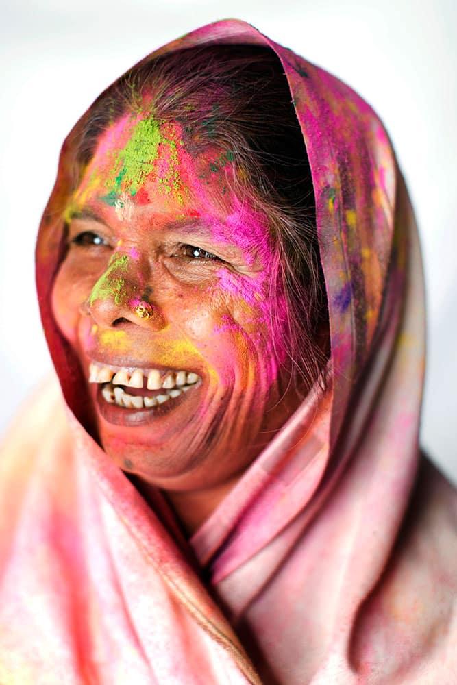 Hindu widow Uma, 65, poses for a portrait after celebrating Holi, the Hindu festival of colors, at the Meera Sahabhagini Widow Ashram in Vrindavan, India.