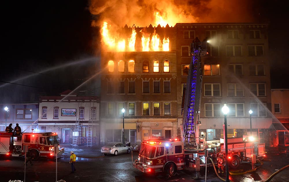 Schenectady firefighters battle a blaze that gutted two five-story apartment buildings in Schenectady, N.Y.
