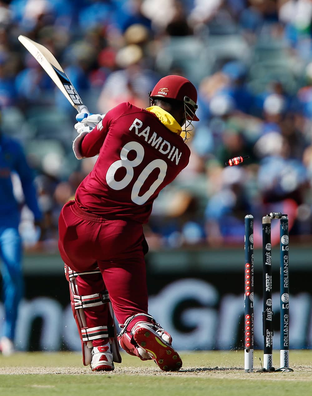 West Indies batsman Denesh Ramdin is bowled for no score during their Cricket World Cup Pool B match against India in Perth, Australia.