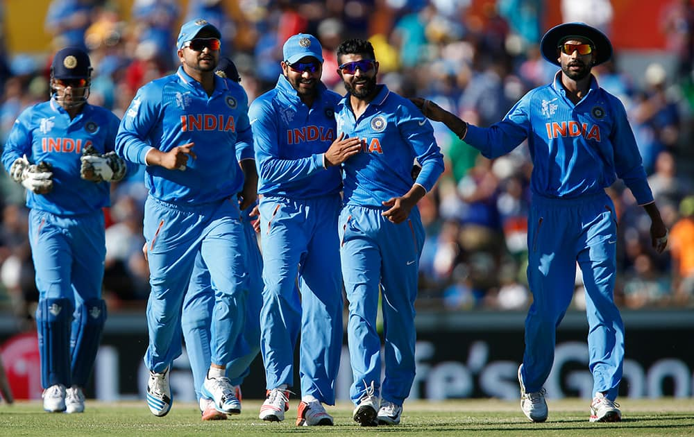 Ravindra Jadeja is congratulated by teammates after dismissing West Indies batsman Andre Russell during their Cricket World Cup Pool B match in Perth, Australia.