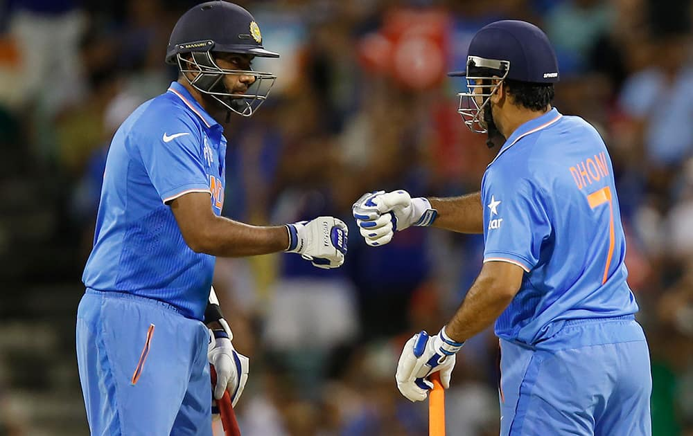 M S Dhoni and teammate Ravichandran Ashwin talk during their Cricket World Cup Pool B match against the West Indies in Perth, Australia.