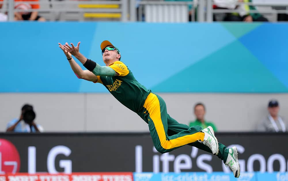 South Africa's Dale Steyn is airborne as he dives to take a catch to dismiss Pakistan batsman Ahmad Shahzad during their Cricket World Cup Pool B match in Auckland, New Zealand.