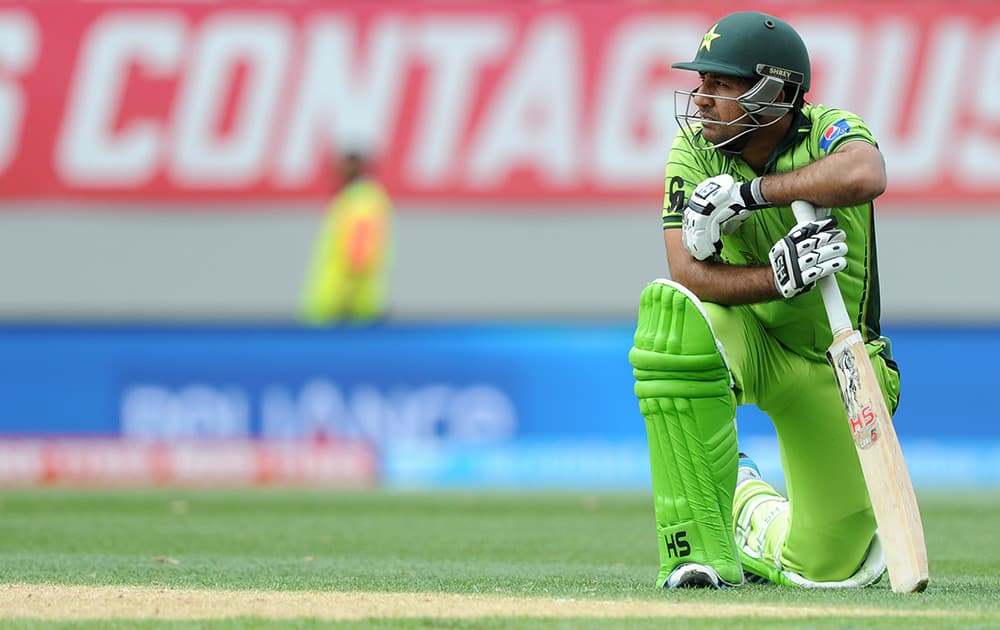 Pakistan's Sarfraz Ahmed rests on his bat after he was run out for 49 runs during their Cricket World Cup Pool B match against South Africa in Auckland, New Zealand.