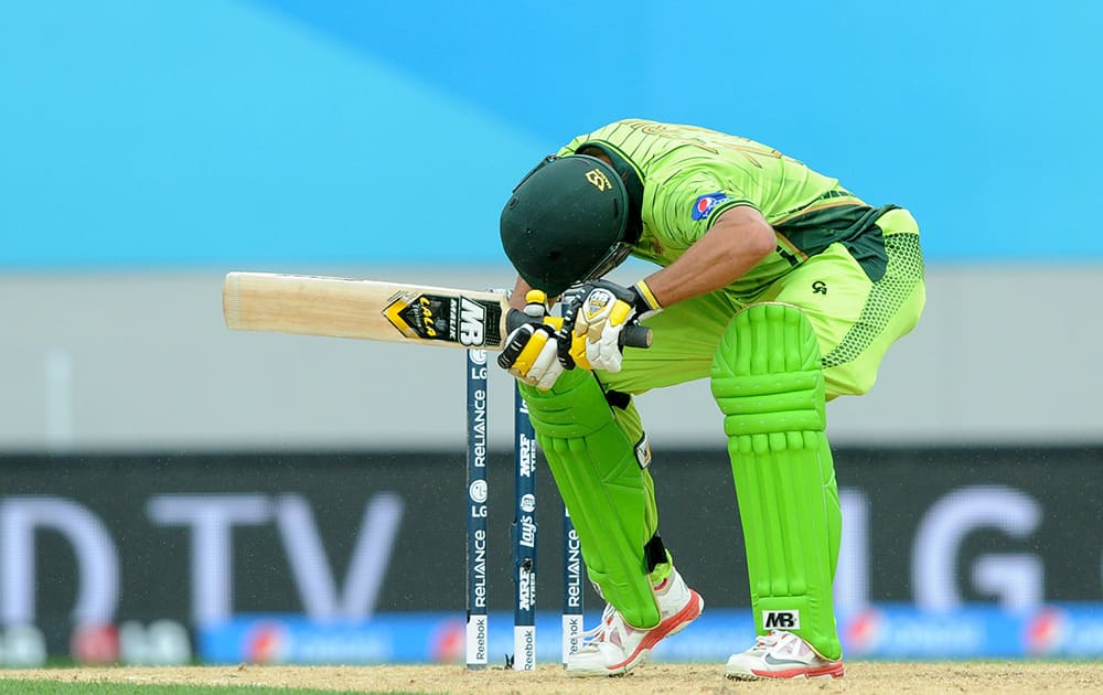 Pakistan's Shahid Afridi ducks under a bouncer while batting against South Africa during their Cricket World Cup Pool B match in Auckland, New Zealand.