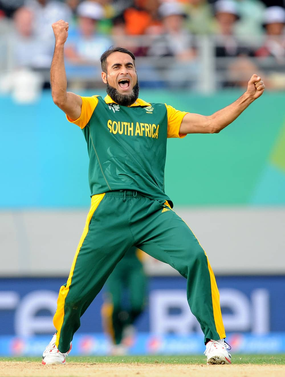 South African bowler Imran Tahir celebrates after taking the wicket of Pakistan batsman Wahab Riaz during their Cricket World Cup Pool B match in Auckland, New Zealand.