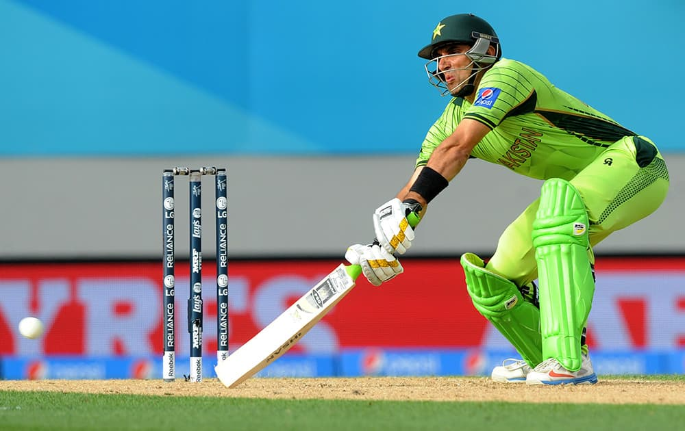 Pakistan's captain Misbah Ul Haq hits the ball while batting against South Africa during their Cricket World Cup Pool B match in Auckland, New Zealand.