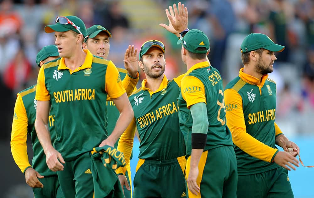 South African player's celebrate after dismissing Pakistan for 222 runs during their Cricket World Cup Pool B match in Auckland, New Zealand.