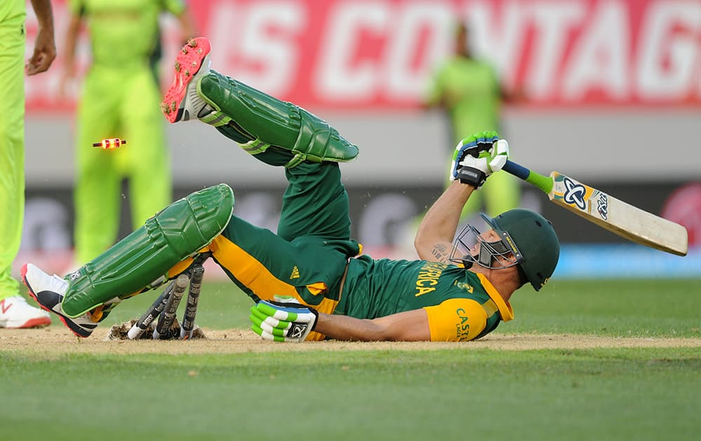 South African batsman Francois Du Plessis rolls on the ground after diving to make his ground while batting against Pakistan during their Cricket World Cup Pool B match in Auckland, New Zealand.