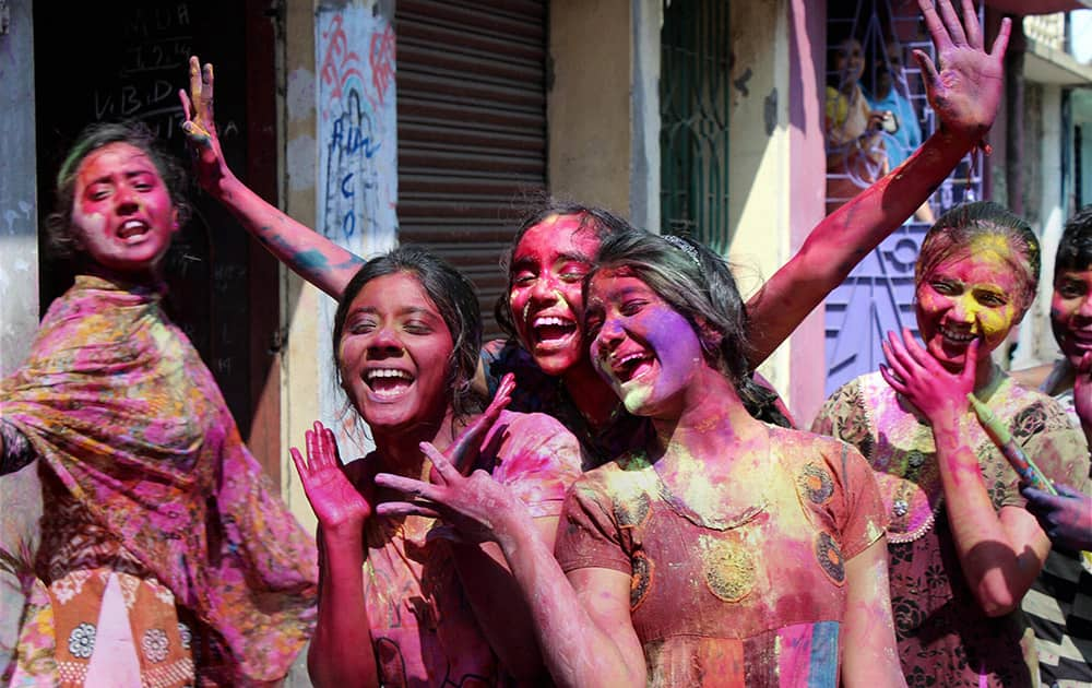 Young girls enjoy during the Holi festival at Malda in West Bengal.