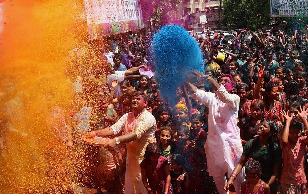 People celebrate Holi in Thane near Mumbai.