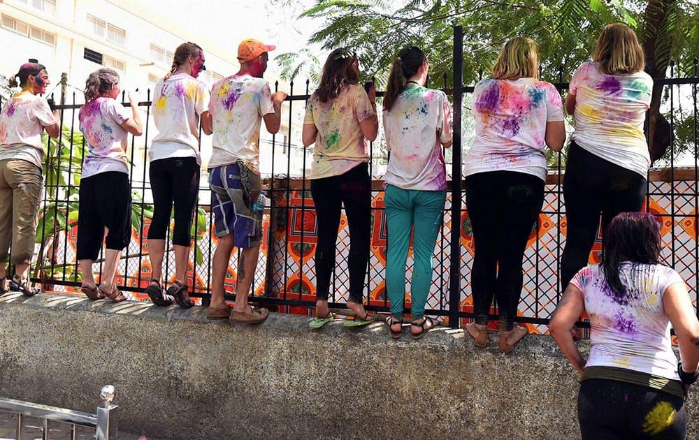 Foreigners celebrate Holi festival in Mumbai.