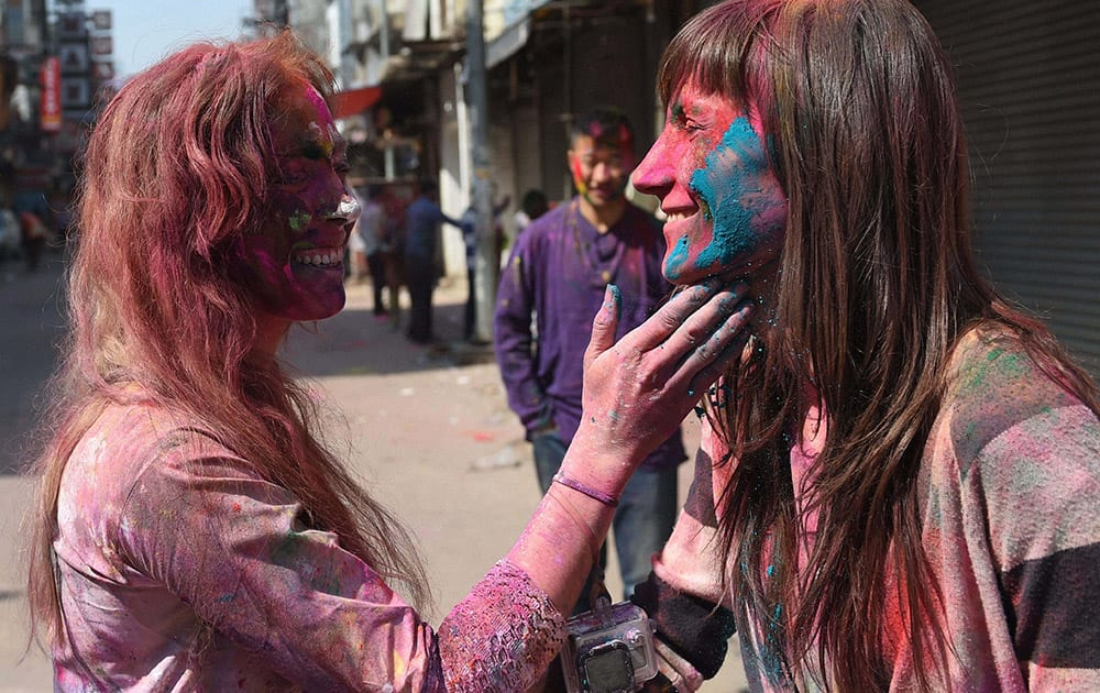 Foreigners celebrate Holi at Paharganj in New Delhi.