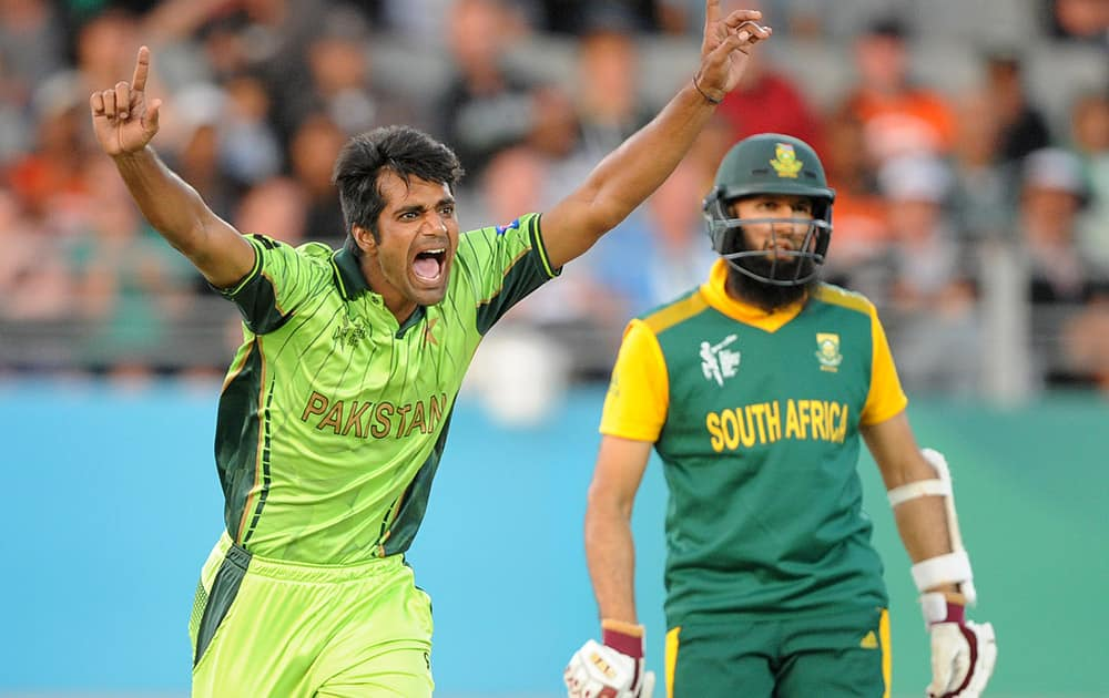 Pakistan's Rahat Ali celebrates after taking the wicket of South Africa's Francois Du Plessis as Hashim Amla watches during their Cricket World Cup Pool B match in Auckland, New Zealand.
