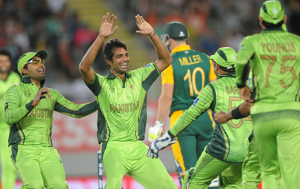 Pakistan bowler Rahat Ali celebrates with his teammates after dismissing South African batsman David Miller during their Cricket World Cup Pool B match in Auckland, New Zealand.