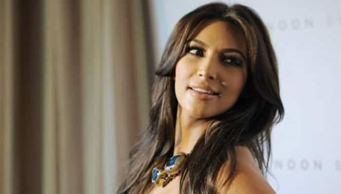 Kim Kardashian poses nude for reality show