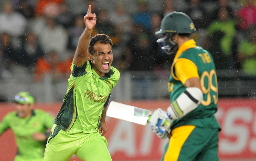 Pakistan's Wahab Riaz runs as he celebrate's the dismissal of South Africa's Muhammad Imran Tahir and their 29 run win over South Africa in their Cricket World Cup Pool B match in Auckland, New Zealand.