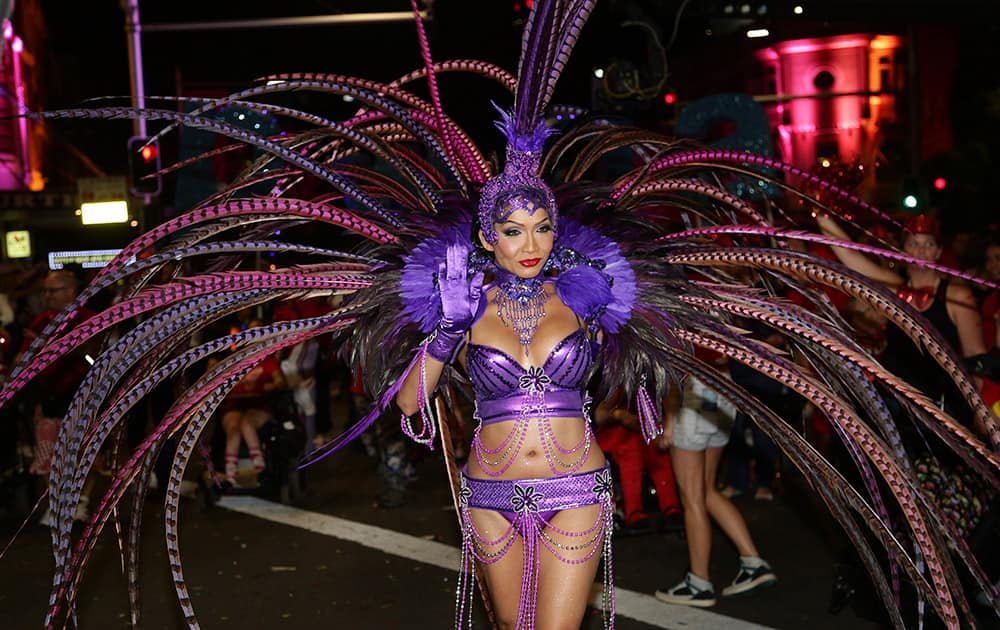A participant of the 37th annual Sydney Gay and Lesbian Mardi Gras Parade performs through Sydney.