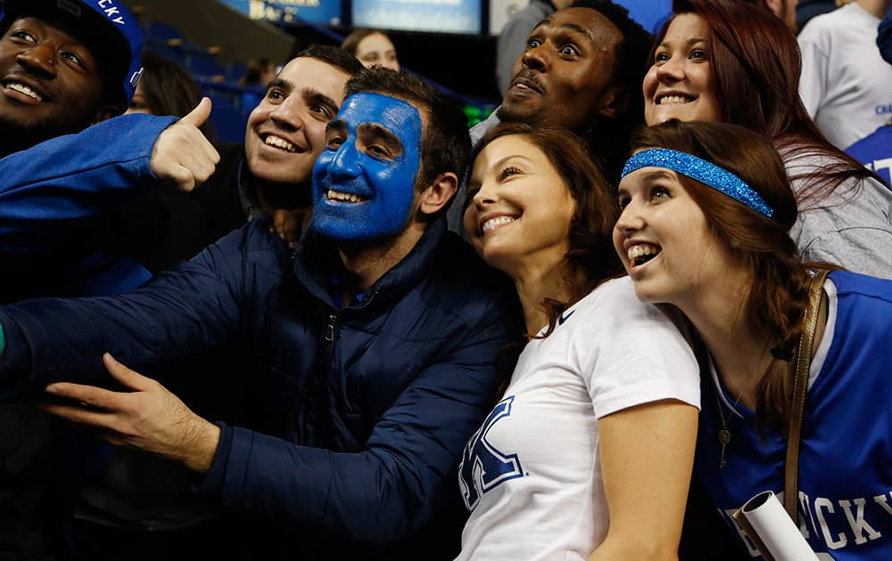 Actress Ashley Judd, second from right, poses with Kentucky fans after an NCAA college basketball game between Kentucky and Florida, in Lexington, Ky. Kentucky won 67-50.