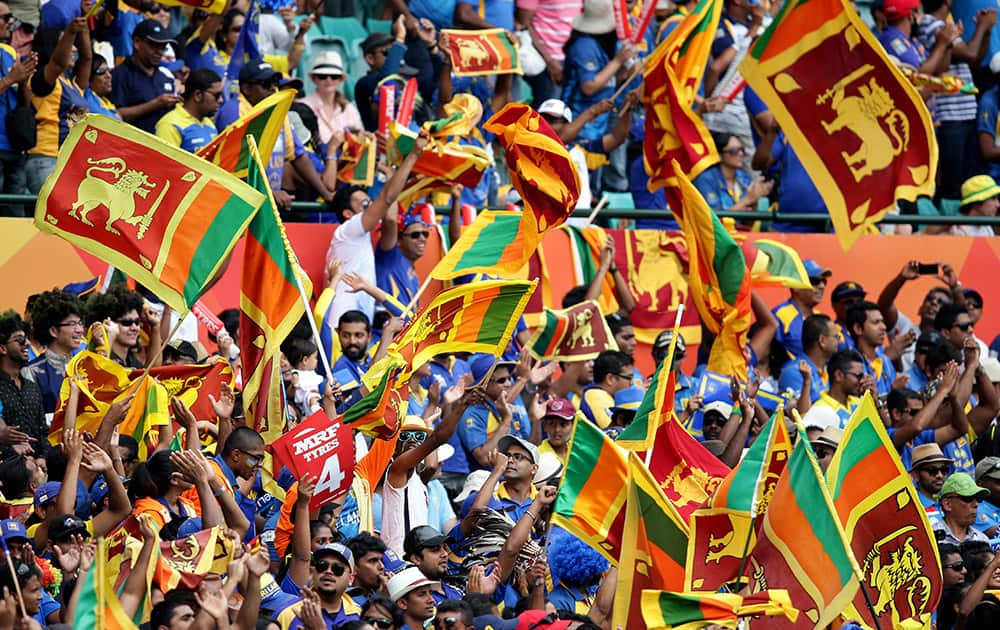 Sri Lankan fans cheer on their team during their Cricket World Cup Pool A match against Australia in Sydney, Australia.