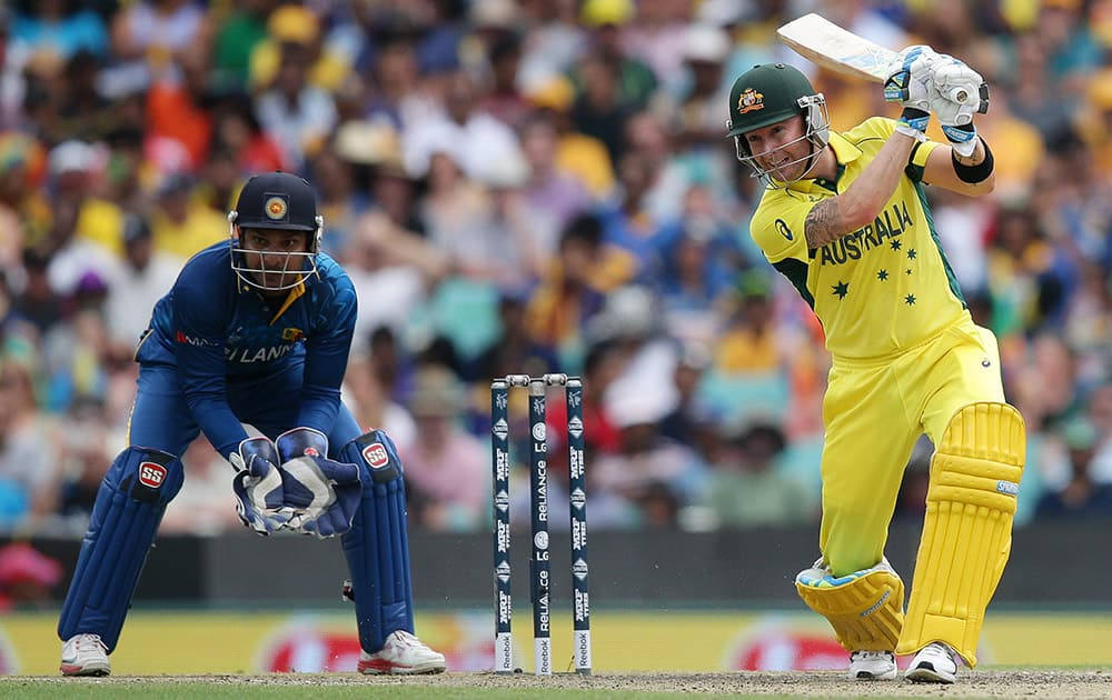 Australian batsman Michael Clarke plays a shot as Sri Lanka's Kumar Sangakkara watches during their Cricket World Cup Pool A match in Sydney, Australia.