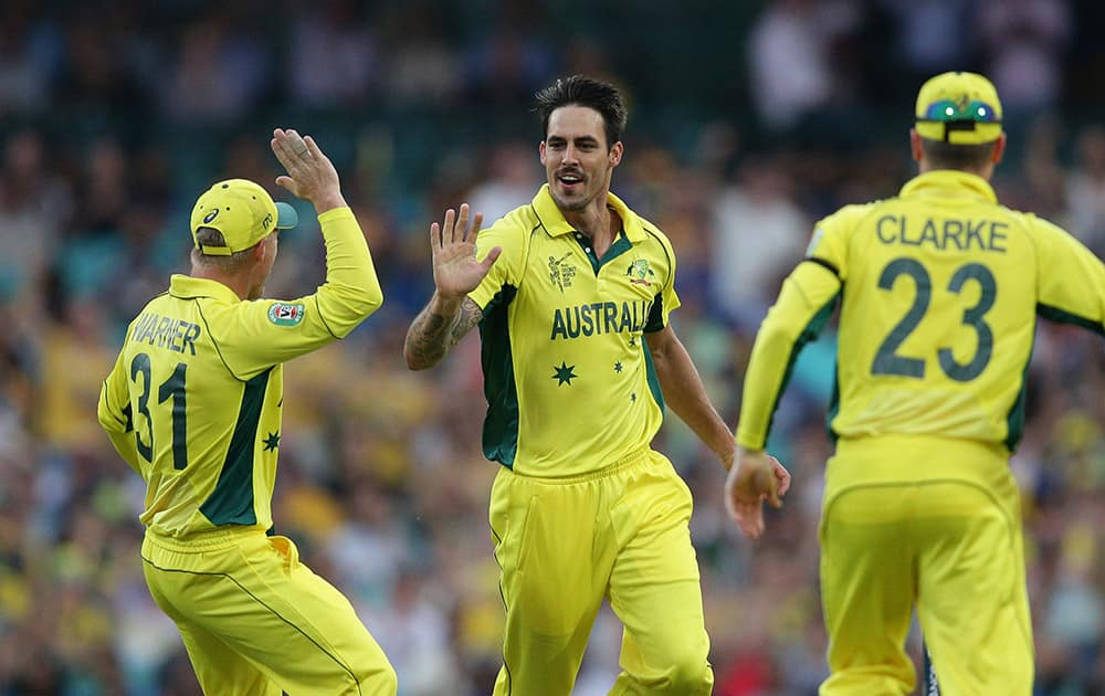 Australia's Mitchell Johnson, center, celebrates the wicket of Sri Lanka's Lahiru Thirimanne, during their Cricket World Cup Pool A match in Sydney, Australia.