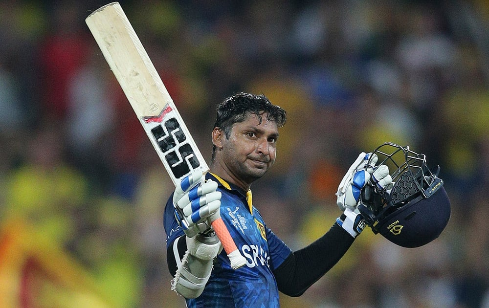 Sri Lanka's Kumar Sangakkara, celebrates his hundred runs during their Cricket World Cup Pool A match against Australia in Sydney, Australia.