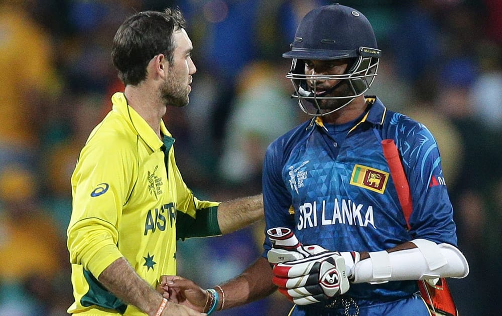 Australia's Glenn Maxwell, left, greets Sri Lanka's Sachithra Senanayake after Australia defeated Sri Lanka in their Cricket World Cup Pool A match in Sydney, Australia.