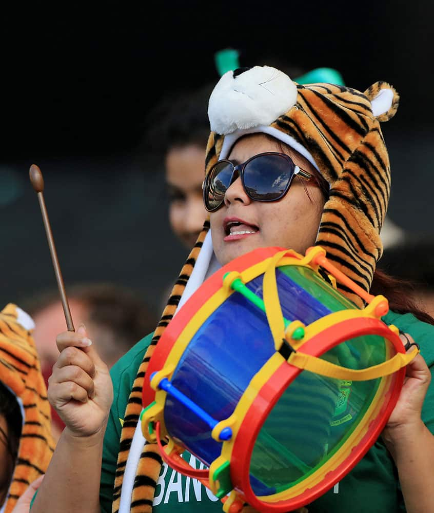 A supporter of the Bangladesh team plays a drum during their Cricket World Cup Pool A match against England in Adelaide, Australia.