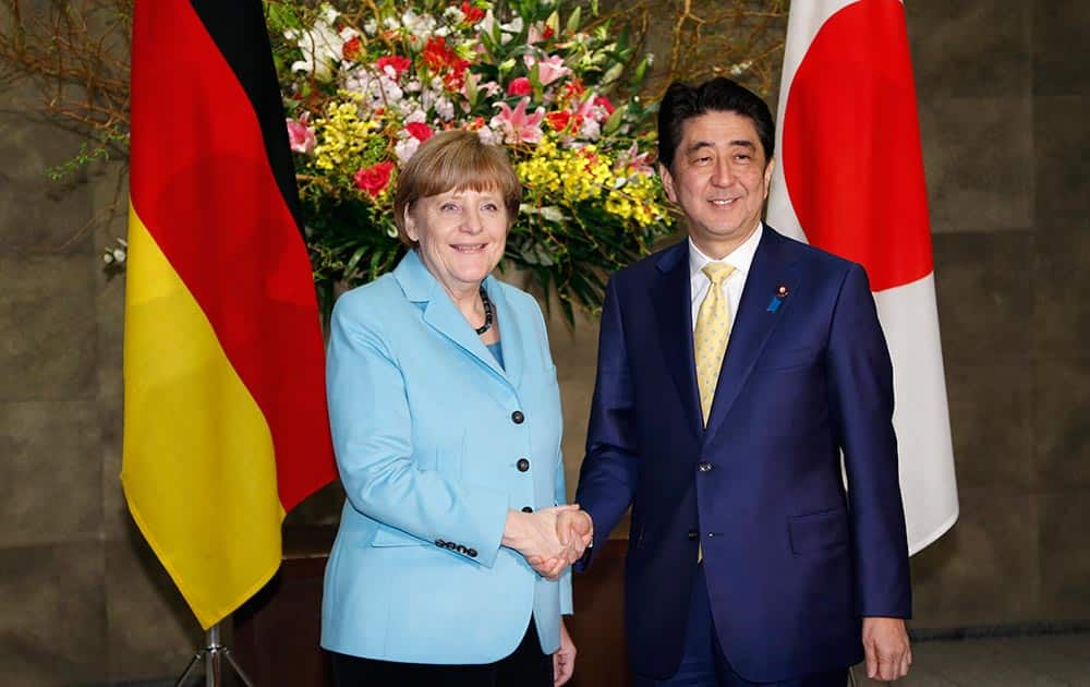 German Chancellor Angela Merkel and Japanese Prime Minister Shinzo Abe pose for photographers prior to a meeting at Abe's official residence in Tokyo.