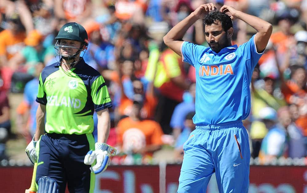 India's Mohammed Shami reacts after bowling as Ireland's William Portfield watches during their Cricket World Cup Pool B match in Hamilton, New Zealand.