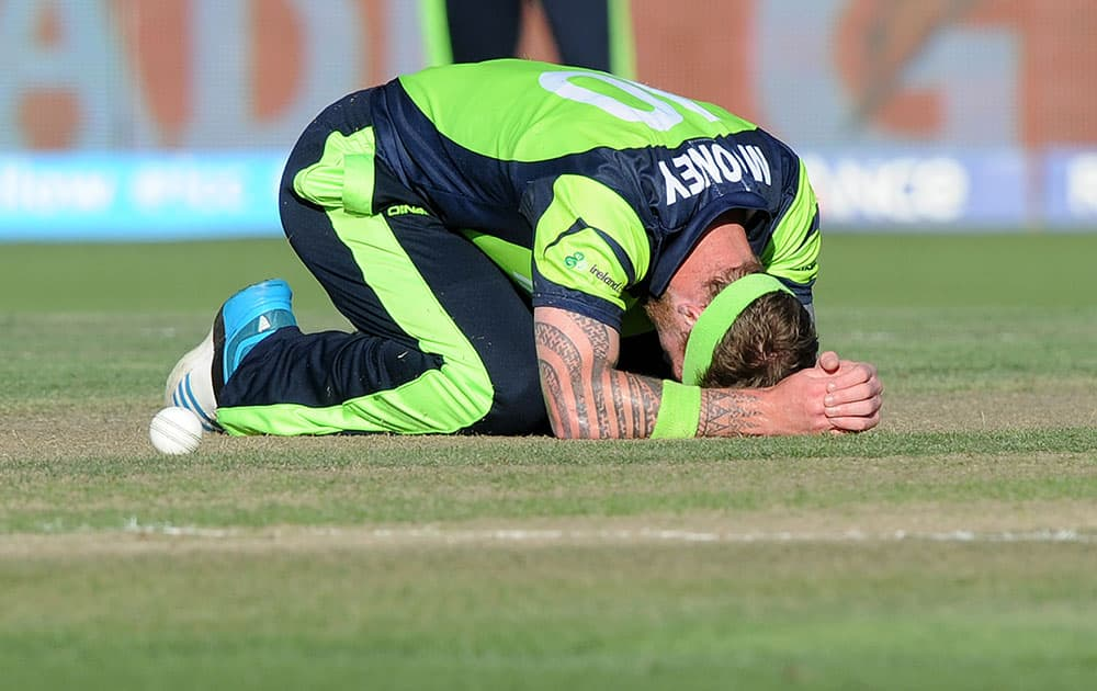 Ireland's John Mooney rests on the ground after he missed a catch chance during their Cricket World Cup Pool B match against India in Hamilton, New Zealand.