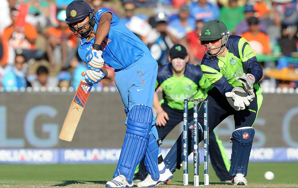 Indian batsman Rohit Sharma plays a shot as Ireland's wicketkeeper Gary Wilson watches during their Cricket World Cup Pool B match in Hamilton, New Zealand.