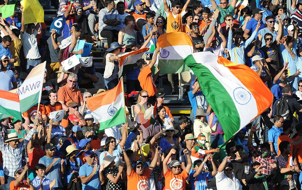 INDIAN FANS CHEER THEIR TEAM ON DURING THEIR CRICKET WORLD CUP POOL B MATCH AGAINST IRELAND IN HAMILTON, NEW ZEALAND.