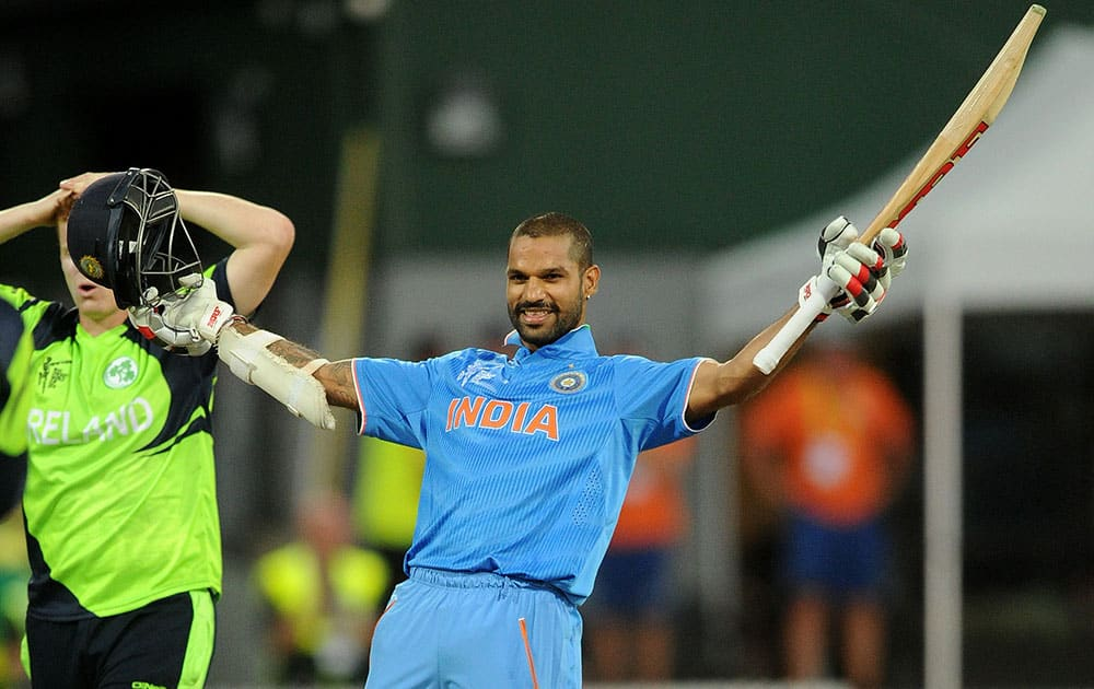 India's Shikhar Dhawan celebrates after scoring a century while batting against Ireland during their Cricket World Cup Pool B match in Hamilton, New Zealand.