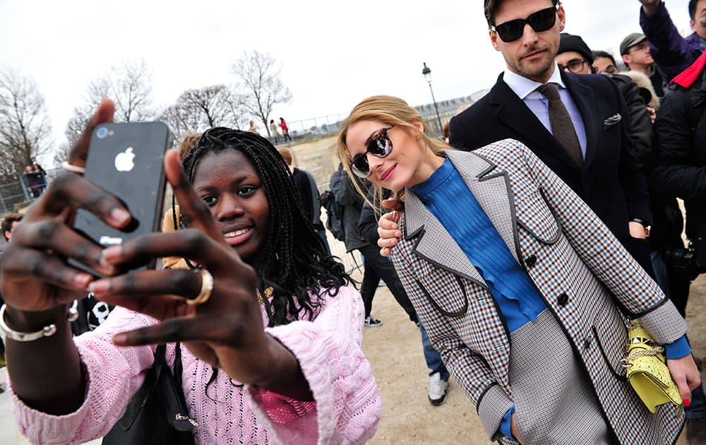 Model Poppy Delevingne pose for a selfie as she arrives at Valentino's ready-to-wear fall-winter 2015-2016 fashion collection presented during the Paris fashion week, in Paris, France.
