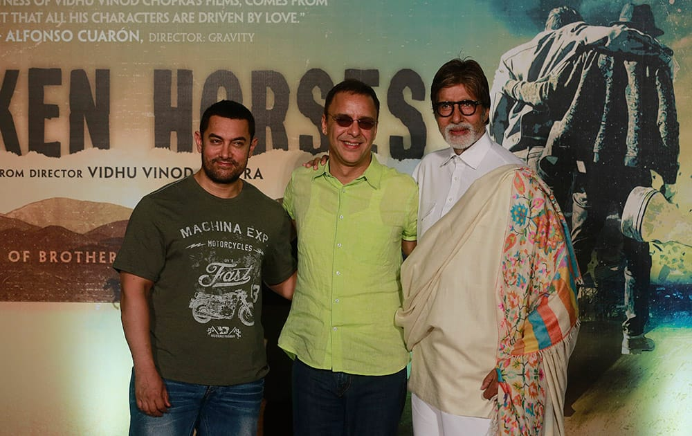 Amitabh Bachchan and Aamir Khan pose with film maker Vidhu Vinod Chopra during the launch of the trailer of Chopra's maiden Hollywood film 'Broken Horses' in Mumbai.