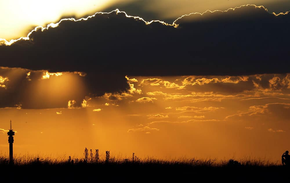 A man watches the sun set in Johannesburg, South Africa.