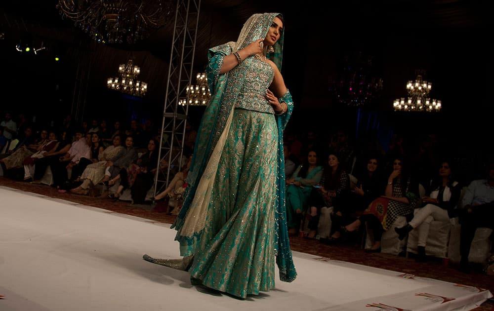 A model presents creations by Pakistani designer Usman Dittu at South Asian Fashion Exhibition 2015 , in Karachi, Pakistan.