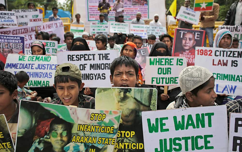 Rohingya refugees living in India hold placards during a protest demanding an end to the violence against ethnic Rohingyas in Rakhine State of Myanmar, in New Delhi.