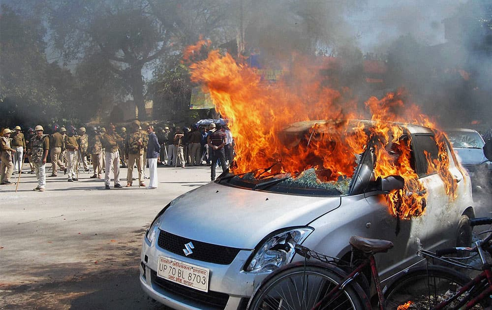 Angry advocates set ablaze vehicles after a clash in the court campus in Allahabad.