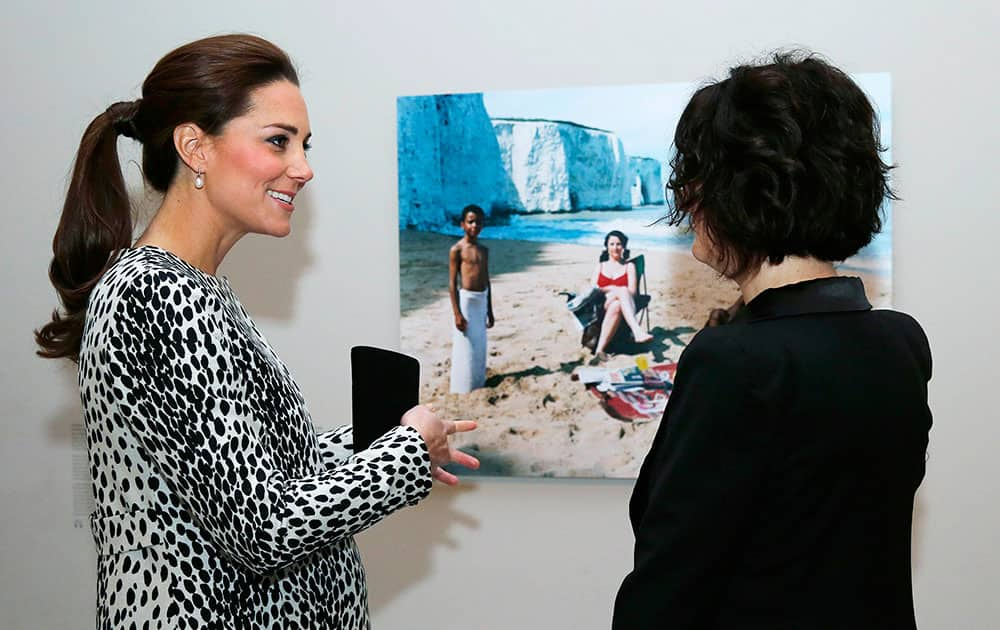 Kate, the Duchess of Cambridge, left, talks with artist Trish Morrissey about her photograph