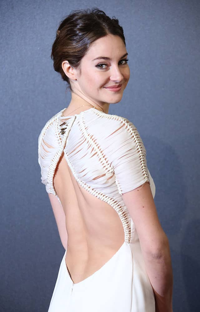 Actress Shailene Woodley poses for photographers upon arrival at a central London cinema for the World Premiere of Insurgent.