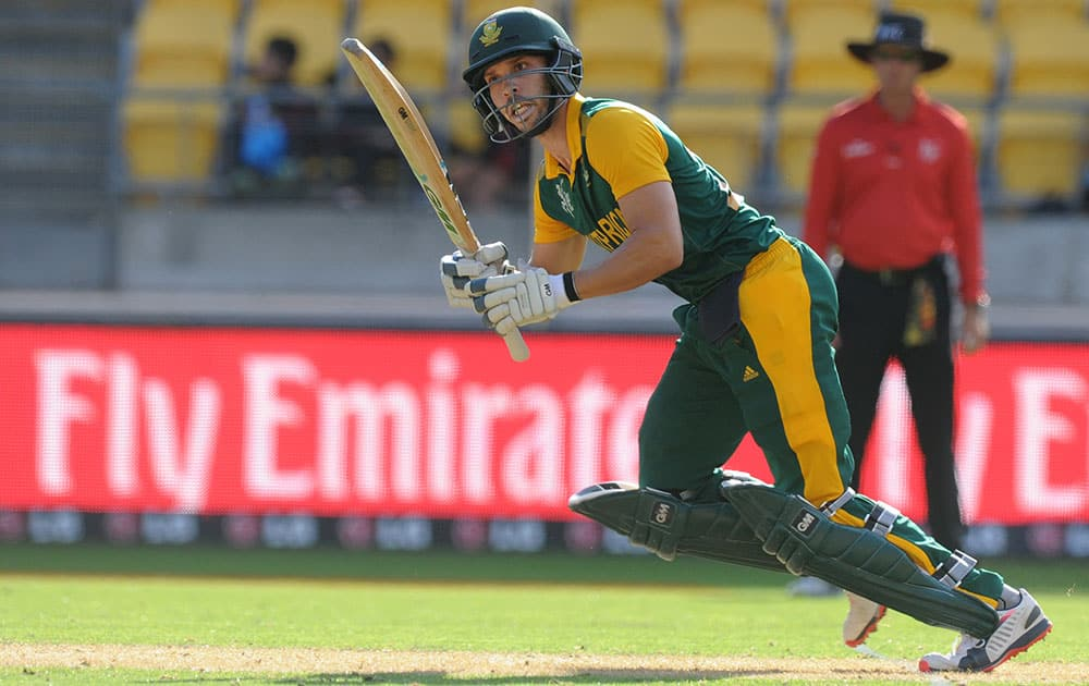 South Africa's Farhaan Behardien hits the ball to the boundary while batting against the United Arab Emirates during their Cricket World Cup Pool B match in Wellington, New Zealand.
